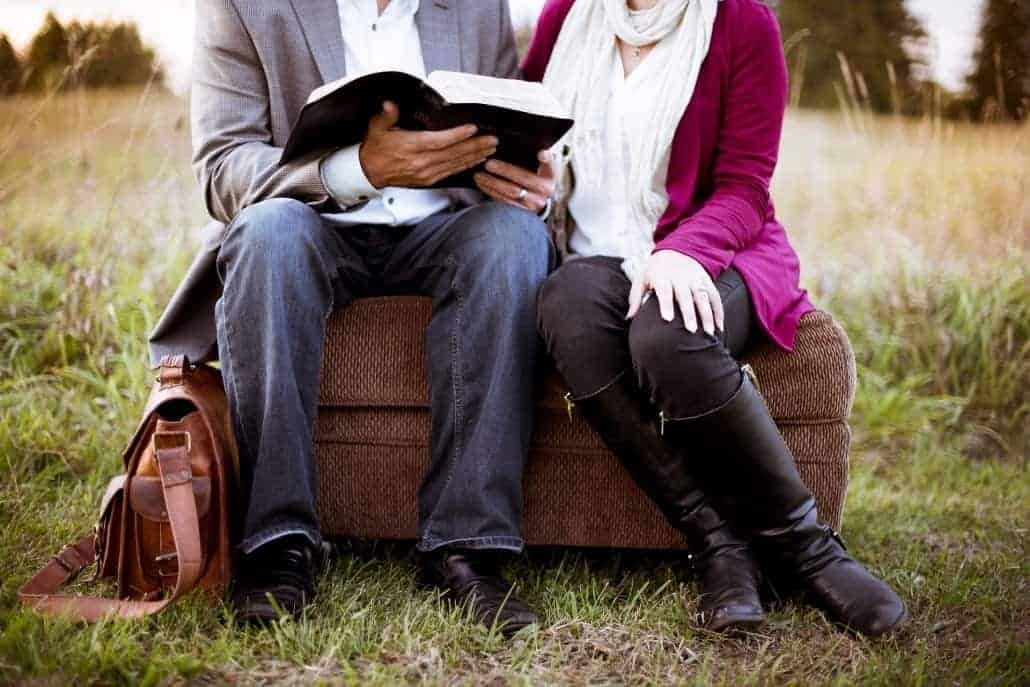 Couple reading in the grass