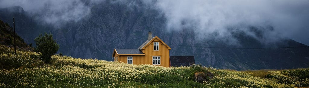 Home in a field with a mountain view